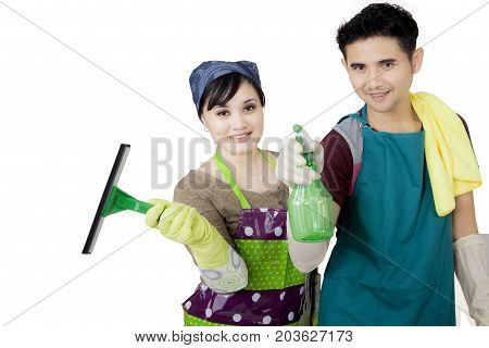 Image of Asian couple cleaning a mirror with a spray and squeegee isolated on white background