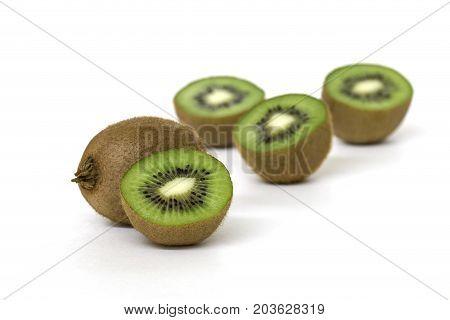Close up of iwi fruit isolated on white background.
