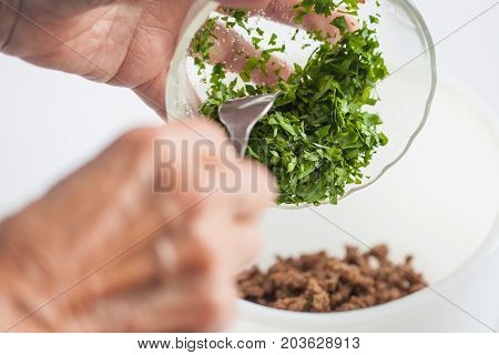 Step By Step Levantine Cuisine Kibbeh Preparation : Mixing The Ingredients To Prepare Kibbeh Filling