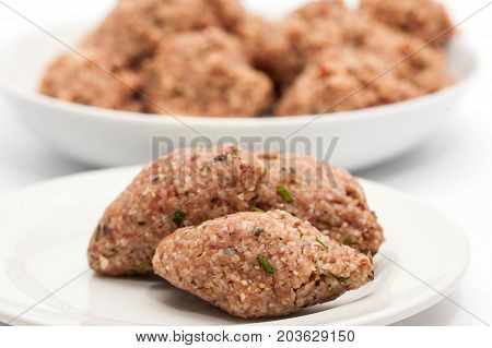 Step By Step Levantine Cuisine Kibbeh Preparation : Raw Kibbeh Balls On White Dish