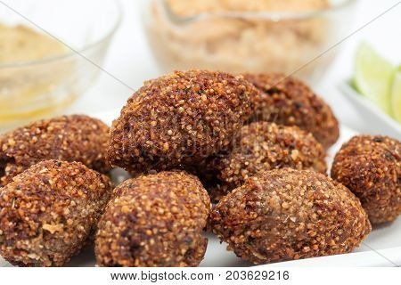 Step By Step Levantine Cuisine Kibbeh Preparation : Ready Fried Kibbeh Served With Tahini And Hummus