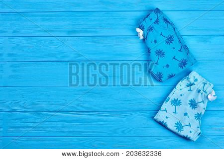 Blue printed infant baby leggings. High quality organic baby pants and copy space. Infant kids summer wardrobe.