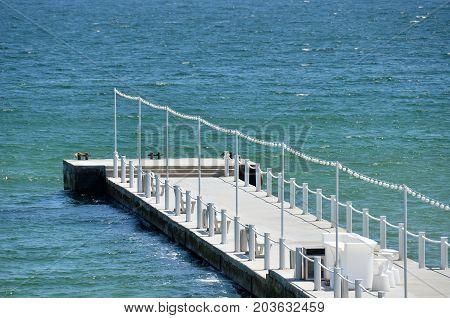 Empty white pier at Black sea Odessa Ukraine