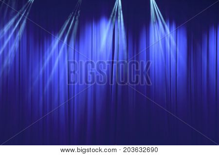 soft blue curtain with light in theater