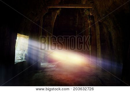 travel in mysterious lands. sunlight shines through the window in the ancient temple in angkor wat area Cambodia