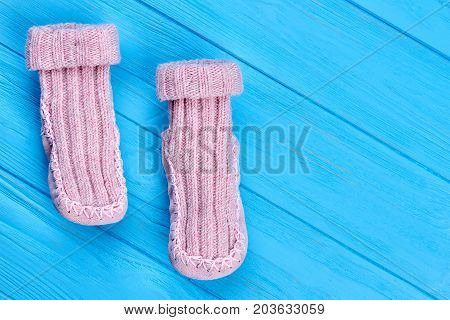 Handmade wool knitted childrens socks. Natural comfortable kids wool socks and copy space. Kids warm knitted socks.