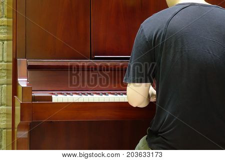 Back View Of Music Performer Playing Piano