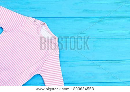 Natural cotton striped clothes for baby. Infant baby natural striped apparel and copy space. Infant kids brand clothes.