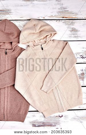 Modern hooded knitted sweaters for kids. Collection of autumn knitted jackets with hoodie for children. Kids knit cardigans on sale.