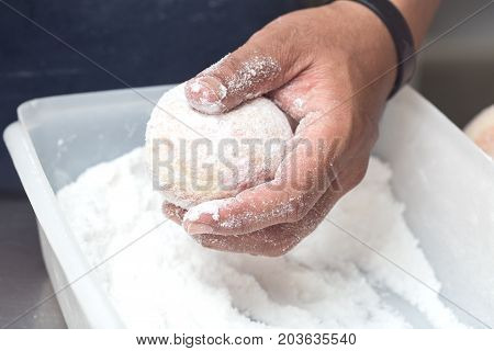 business bakery closeup hand work icing donut jam background