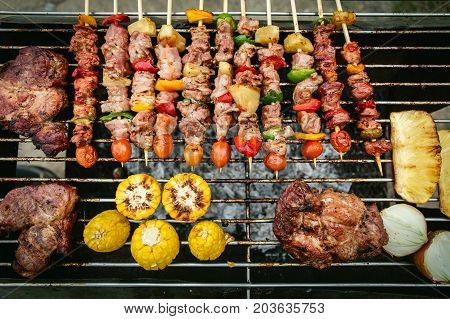 Bbq Grill With Pork And Vegetable On Fire.