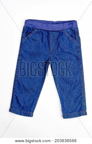 Baby-boy denim jeans isolated. High quality pocket denim trousers for baby-boy, white background. Infant boy brand jeans on sale.