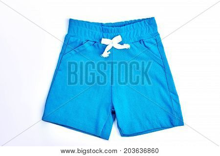 Toddler boy light blue cotton shorts. Kids natural cotton shorts isolated on white background.