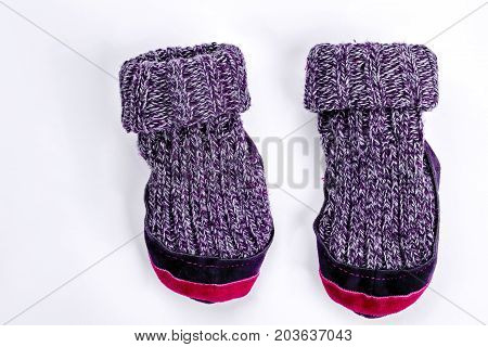 Kids two woolen knitted socks. Cute childrens warm knitted socks isolated on white background.