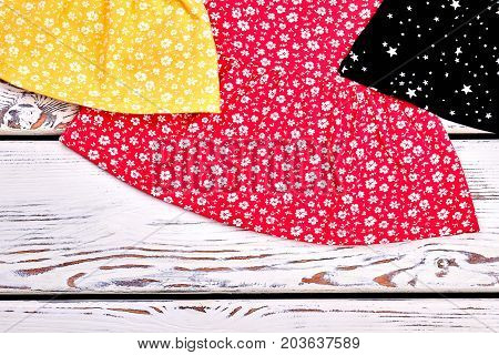 Cropped image of baby-girl dresses. Toddler girl cotton casual clothes close up. Little girls summer apparel.
