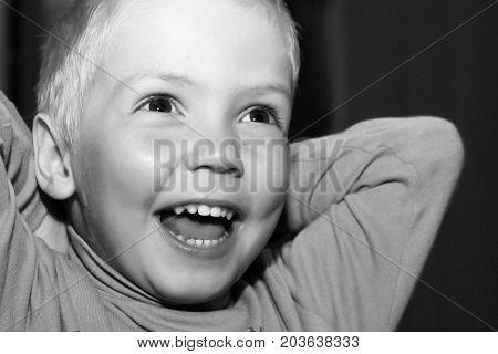 The Little Blond Boy Is Very Happy