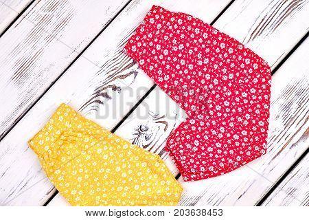 Baby girl lovely harem pants. Toddler girl cute harems on old wooden background. Infant girl summer pants on sale.