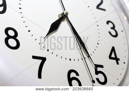 White Clock With Black Numbers Closeup