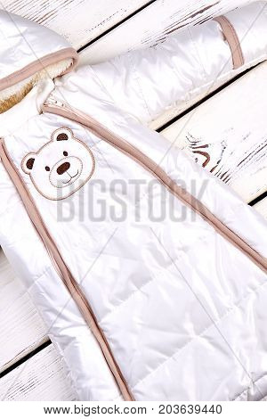 Thick warm infant baby romper. Warm comfortable snowsuit for babies, top view. Infant baby winter jumpsuit.