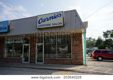 CREST HILL, ILLINOIS / UNITED STATES - JULY 20, 2017: One may have one's hair cut at Carmie's Coiffure Salon, at the end of a strip mall on Plainfield Road.