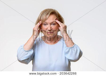 Senior Woman Suffering From A Severe Headache