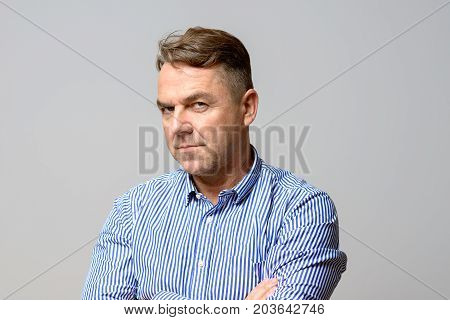 Thoughtful Determined Middle Aged Man