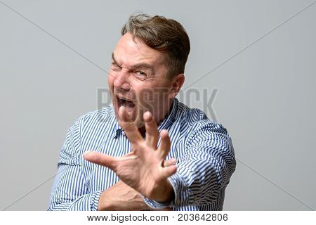 Middle Aged Man Screaming At The Camera