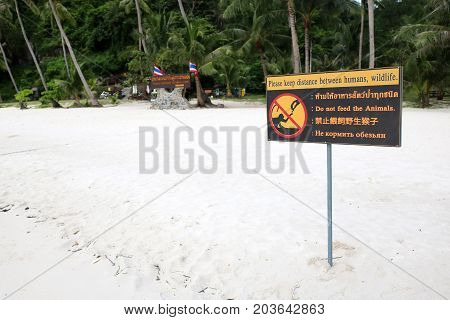 Multilanguage sign languages for don't feed the animals on the beach in Thailand.
