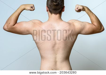 Fit Muscular Young Man Flexing His Muscles