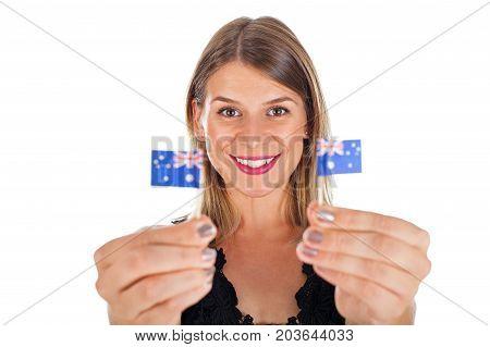 Beautiful australian female holding a mini national flag smiling at the camera on isolated