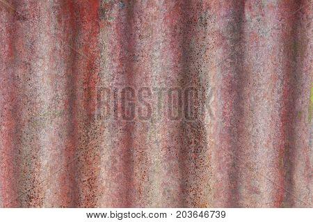 Rusty galvanized iron sheets background pattern extreme closeup