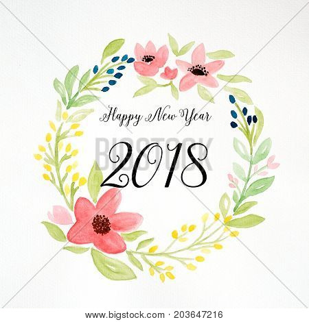 Happy new year 2018 on hand painting flowers wreath in watercolor style over white paper background flowers wreath new year greeting card