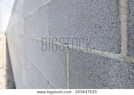 Clean and straight cinder block wall background texture perspective with shallow focus