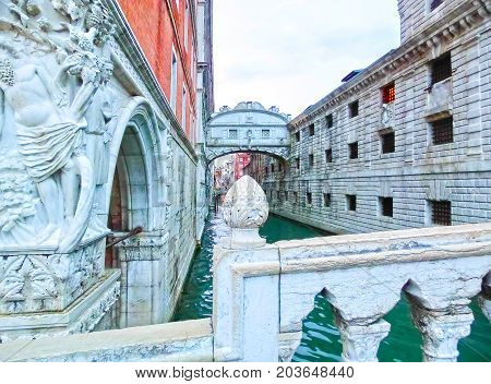 Venice, Italy - May 04, 2017: Corner statue of the historical Doge's Palace near by the venetian prison at Venice, Italy on May 04, 2017