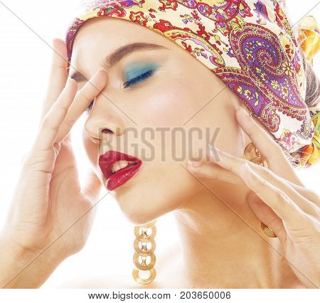 young pretty modern girl with bright shawl on head emotional posing isolated on white background, asian people ethnicity closeup