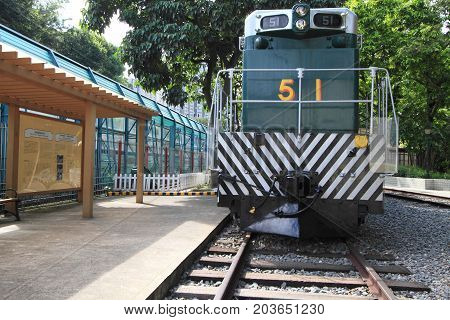 HONG KONG -JULY 16, 2014: Retired historical green trains at Tai Po on July 16, 2014 in Hong Kong. This historical diesel locomotives are parked at the only railway museum in Hong Kong.