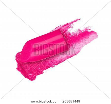 Pink lipstick smear with a slice of lipstick closeup isolated on a white background