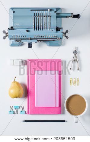 Old calculating machine notebook and stationery on white background