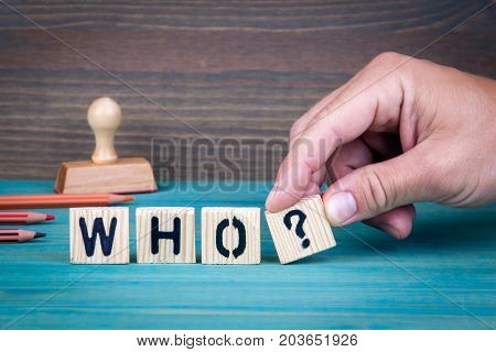Who. Wooden letters on the office desk, informative and communication background.