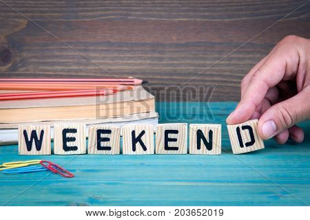 Weekend. Wooden letters on the office desk, informative and communication background.