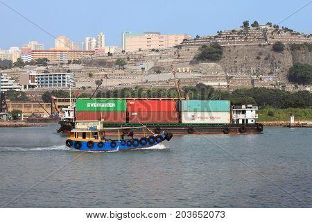 HONG KONG, CHINA - OCT 6, 2014: View of Rambler Channel on Oct 6, 2014 in Hong Kong, China. Many boats and ships pass through this busy logistics hub in Hong Kong.