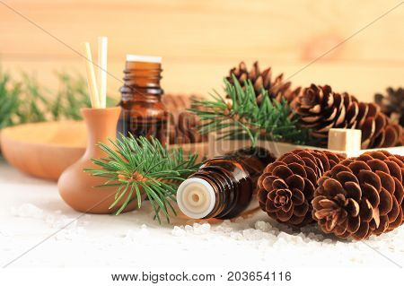 Fresh winter home scent. Medicinal amberglass dropper bottle with green fir-needle and cones, aromalamp diffuser for relaxing healthy spa.