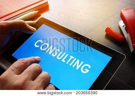 Online Consulting concept. Advisor is holding tablet.