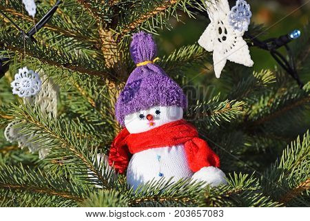 Snow man figurine in the christmas tree Winter time