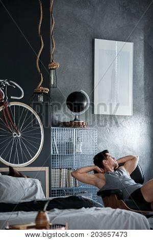 Man Chilling On Black Chair