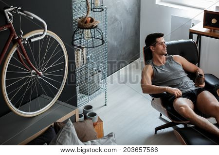 Man Relaxes On Leather Chair