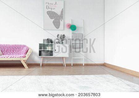 Pink Blanket On Wooden Sofa