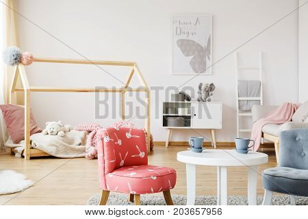 Two Cups On Small White Table