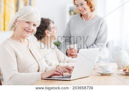 Elderly Woman Doing Online Shopping