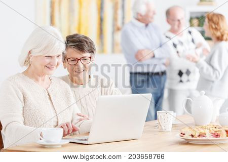 Happy Senior Ladies Using Technology